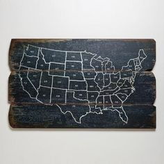 "Wood USA Wall Map is drawn in white that contrasts with the rustic black background of the wood panels. Cost Plus World Market $80, 47"" x 35"""