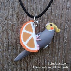 A cinnamon cockatiel hanging from an orange slice. This lightweight pendant has a completely three dimensional design and can be worn from either side. He makes a great gift for any parrot lover. Clay Birds, Pet Birds, Parrot Toys, Black Gift Boxes, Fitness Gifts, Cockatiel, Deco Design, Blue Bird, Your Pet