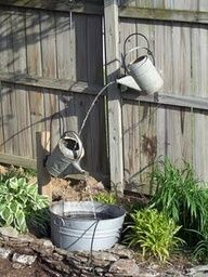 yard art ideas from junk | Galvanized Watering Can Fountain Tutorial