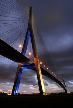 The Pont de Normandie is cabled-stayed bridge that spans the river Siene to Normandy. Its total length is 2,143.21 meters (7,032 ft) and a height of 215 meters making it the 8th tallest bridge in the world.