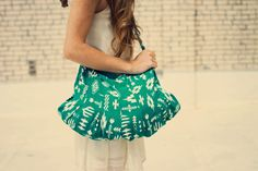 Turn an old skirt into a cool carryall with this tutorial.
