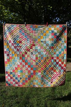 Scrappy Trip Around the World quilt by Buttontree Lane, via Flickr. Love the concentric circle quilting!