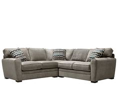"""This Artemis II 3-piece microfiber sectional sofa is so easy to decorate with. Its stone color is what designers are calling the """"new neutral."""" It's not a typical beige, but its deep, slate gray hue will still work with just about anything, even its striking multicolored accent pillows. Plus, this sectional sofa is so comfy to curl up on."""