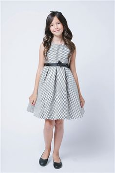 This petite polka dot jacquard graduation dress is ideal for her big debut! Avaialble in two colors!