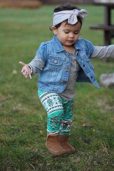 toddler girl walking, wearing mint green leggings and brown boots