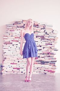 awesome photo backdrop.  To bad it would take a really long time to set up and take a long time to accumulate all of those books!