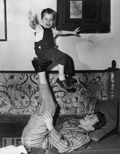 Kirk Douglas Balances Son Michael in 1948