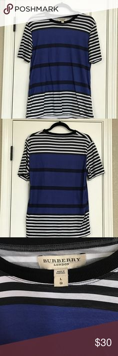 Large Burberry Men's Shirt Large stripped Men's Burberry shirt. Worn a few times. Stripes are royal and navy blue. Collar of shirt is black. Great shirt for summer! Burberry Shirts Tees - Short Sleeve