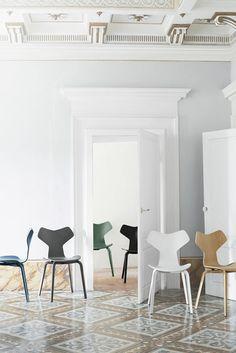Danish furniture design brand Republic of Fritz Hansen has reintroduced Modernist architect Arne Jacobsen's Grand Prix chair with new wooden legs.