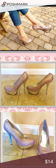 "Sparkly pink lavender&silver platform heels sz6 These are beautiful sparkle bling pink, lavender and silver platform heels bamboo designer brand sz 6 in good gently pre owned condition only right back heel has slight crease to it but prob.  easily could be smoothed out with wearing! Heels is about 4.25 with about a 1 1/2"" platform BAMBOO Shoes Heels"