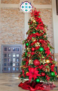 Christmas Tree Decorated In Traditional Red Gold And Green With Oversized Decorations For A