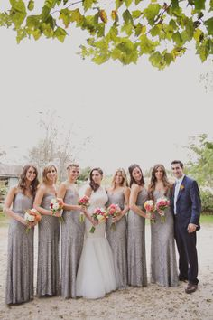 Sparkly bridal party with bright bouquets: http://www.stylemepretty.com/2014/12/17/romantic-marthas-vineyard-wedding/ | Photography: Our Labor of Love - http://ourlaboroflove.com/