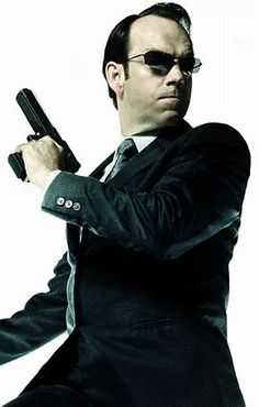Hugo Weaving as Agent Smith, The Matrix Agent Smith, Hugo Weaving, Fiction Movies, Science Fiction, Keanu Reeves Matrix, The Matrix Movie, Carrie Anne Moss, Movie Shots, Stylish Clothes