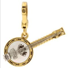 Juicy couture charm Juicy couture charm. It is a cute banjo. It is from 2010. Super rare and limited edition. Original box. Juicy Couture Jewelry