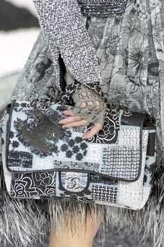 Chanel ~ The cut-work, fingerless gloves and the skirt are the items I most love here...lovely sleeve to the jacket too...