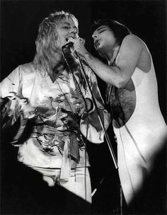 Freddie Mercury and Roger Taylor live on stage on the UK Summer tour. Here performing '39 in Hyde Park on 18th September 1976.