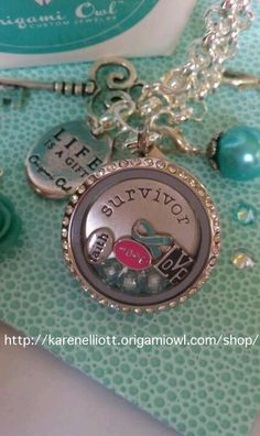 Ovarian Cancer Origami Owl locket Or look online. We have many cause ribbons - pink, yellow, purple, orange, white and blue (shown). Look online and order one today to support someone you love Origami Owl Fundraiser, Origami Owl Parties, Origami Owl Lockets, Origami Owl Jewelry, Ovarian Cancer Awareness, Cervical Cancer, Survivor Necklace, Be My Hero, Locket Bracelet