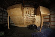 An awesome home climbing wall. Someday I'll have one of these!
