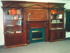 This would look good in a lawyer's office too. Tv Fireplace, Custom Fireplace, Fireplace Surrounds, Entertainment Center Wall Unit, Entertainment Room, Lawyer Office, Fluted Columns, Architrave, Formal Living Rooms