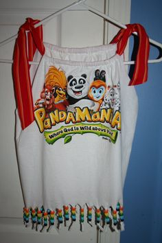 2011 VBS Shirt - made using last year's old VBS shirt modified via the tutorial in the June issue of Disney Family Fun with pony beads added to the bottom and ribbon that was used in the packaging of a pair of pajamas from Old Navy.