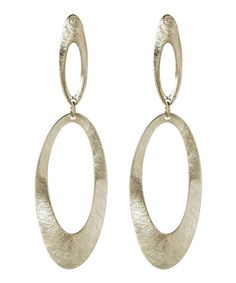 Two oblong ovals join to form these chic earrings that promise to impress with their sense of artistic allure and textured shine. 1'' W x 3'' LBrassImported