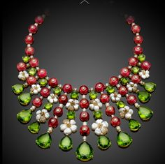 Bulgari's incredible one-of-a-kind necklace from the exclusive Diva collection is composed in yellow gold set with mother of pearls with with 217.94ct rubellites, 184.03ct peridots and diamond pavé...g