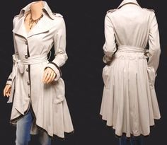 New look in espionage trench coats. Perhaps a look for Kate on Pan AM. Love the draping!