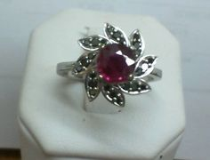 Ruby set with black diamonds in flower petal setting