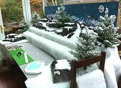 view of the table stand, with snow fabric and mountains added White Christmas Trees, Christmas Mom, Silver Christmas, Victorian Christmas, Vintage Christmas Ornaments, Christmas Decorations, Christmas Ideas, Diy Christmas Village Displays, Miniatures