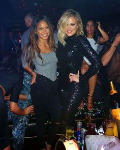 Khloe Kardashian looked like she was having a great time at Malika Haaq's birthday party in Las Vegas where she wore a black figure-hugging sequined bodysuit - she even got a lap dance from a friend