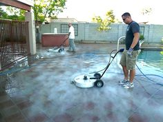 Steam cleaning a back yard patio and pool area. These Arizona powerwash techs are using industrial surface cleaners to pressure wash the surface and remove dirt, spills, and other stains. http://www.powerwashaz.com