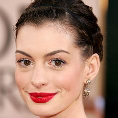 """ANNE HATHAWAY - 2006 The Devil Wears Prada star played up her complexion with high-contrast matte red lips. """"Annie has perfect, almost alabaster skin—with absolutely no imperfections,"""" said makeup artist Kate Lee."""
