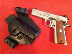 Tueller Holsters IWB1 and Ruger SR1911 Commander.  Tueller holsters are very well made in Boise Idaho, and have a reasonable turn around time.