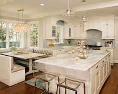love the vibe of this kitchen...love everything except those clear chairs and light fixtures.