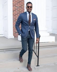 burntpeakedlapels:    I love contrasting a solid navy blazer with some statement trousers like these tartan ones I just copped for winter. What do you guys think?  or   #GregsStyleGuide #Dapper #MensFashion (at Orlando Florida)
