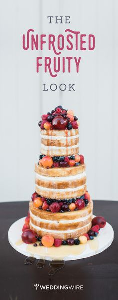 A delicious naked wedding cake with fresh fruit and honey drizzled down sides. Can you say yum?! {Angela Newton Roy Photography}