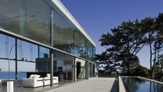 Cliff House in New Zealand: Beautiful Glass House Overlooking a Gulf Nothing could be better than a glass house on a cliff overlooking the gulf.       For sure, this isn't the first time that you will see a house that is surrounded with glass. Using glass would make the house l...