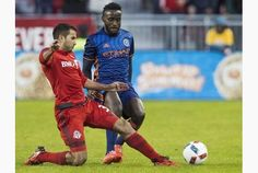 Toronto FC's Steven Beitashour, left, kicks the ball against New York City FC Stiven Mendoza during the first half of MLS soccer action in Toronto, Wednesday May 18, 2016. Fullback Steven Beitashour knew something was very wrong when he couldn't sleep following Toronto FC's victory over Montreal in the Canadian Championship final. THE CANADIAN PRESS/Mark Blinch