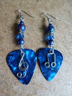 Beaded Guitar pick earrings. $20.00, via Etsy.