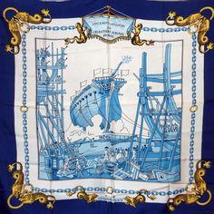 """Foulard carré de soie Hermès """"Lancement d'un vaisseau aux chantiers navals du roy """" coloris bleu, par Pierre Perron, première édition de 1970."""