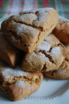 Gingerbread Scones. Made with flour, brown sugar, baking powder, ginger, baking soda, salt, cinnamon, butter, molasses, milk, egg, and sugar.
