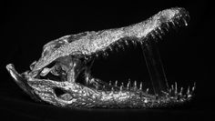 - Nile crocodile Skull in silver -   The reproduction of Nile Crocodile Skull in solid silver was made possible following the use of a historical than traditional purchasing technique hyperrealist, could be carried out directly on the sample authentic, through use of the silicone rubber. The skull in question is an original from the Salon of the Skeletons of the Museum of Natural History ( and Physics as well as the Imperial and Royal Museum ) in Florence.