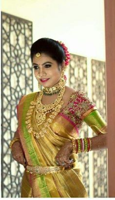 South Indian bride. Gold Indian bridal jewelry.Temple jewelry. Jhumkis.Gold silk kanchipuram sari.Braid with fresh jasmine flowers. Tamil bride. Telugu bride. Kannada bride. Hindu bride. Malayalee bride.Kerala bride.South Indian wedding.