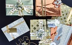 A bird's eye view of glamorously wrapped gift boxes in gold, copper and silver…