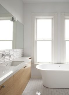 Use Frosted glass to get a naturally lit bathroom with privacy. It has an ethereal feel