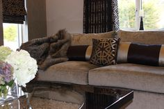 Large comfy sofas in luxurious fabric softened with complimentary cushions and faux fur throw.