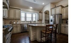 Love this kitchen- sounded island with seating, cabinets color, stainless appliances