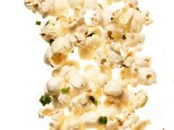 Garlic-Herb Popcorn - Melt 4 tablespoons butter in a saucepan; add 4 grated garlic cloves and 1 teaspoon each finely chopped fresh rosemary, sage and thyme and cook1 minute. Drizzle over 16 cups hot popcorn and toss with 2 teaspoons kosher salt.