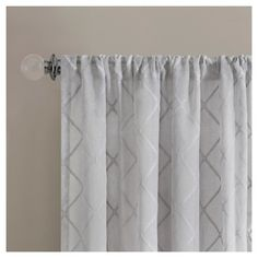 • soft, durable polyester construction<br>• easy-hang pocket top<br>• easy care machine washable<br><br>Update your living room or bedroom in a flash with the fresh look of the Clarissa Diamond Sheer Curtain Panel. Soft pastel colors are accented by charming diamond patterns to bring a delicate look to your décor—from traditional to contemporary. Pocket-rod-top design makes for super quick installation, as no hooks are need...