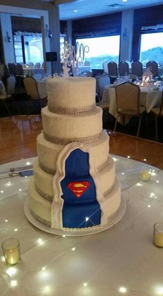 Superman wedding cake The Effective Pictures We Offer You About traditional wedding cakes with fountain A quality picture can tell you many things. You can find the most beautiful pictures that can be Superman Wedding Cake, Superman Cake Topper, Superhero Wedding Cake, Avengers Wedding, Superman Cakes, Wonder Woman Wedding, Fountain Wedding Cakes, Traditional Wedding Cakes, Our Wedding
